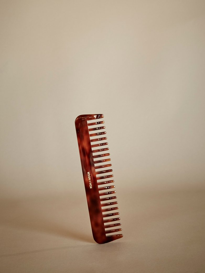 Comb with Spaced Pegs