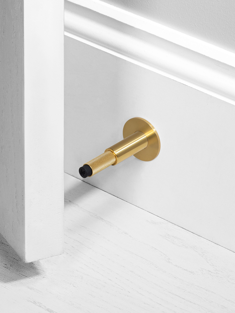 DOOR STOP - WALL MOUNTED, BR