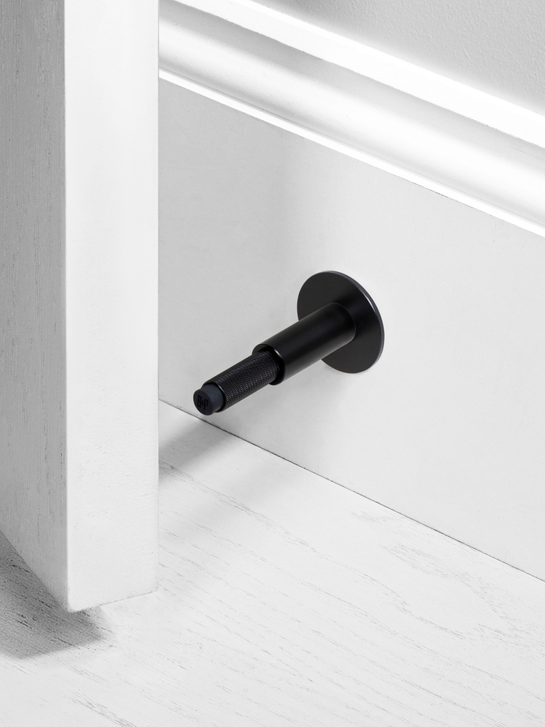 DOOR STOP - WALL MOUNTED, BL