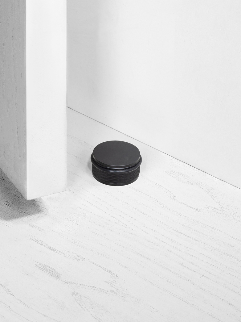 DOOR STOP - FLOOR MOUNTED, BL