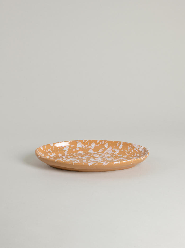 Spruzzi Vivente - Oval Plate Medium - White on Terracotta