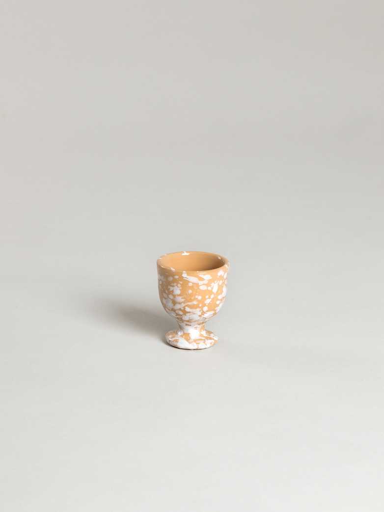 Spruzzi Vivente - Egg Cup - White on Terracotta